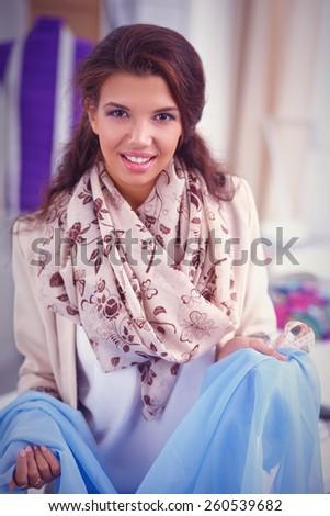 Portrait of beautiful female fashion designer working - stock photo