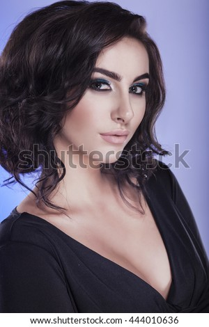 Portrait of beautiful female model in studio