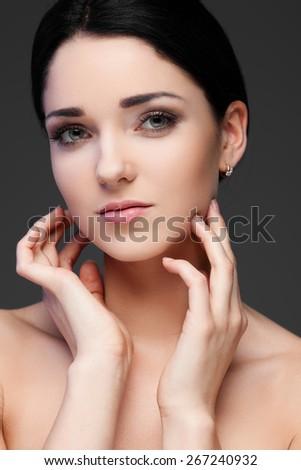 Portrait of beautiful female model on dark background - stock photo