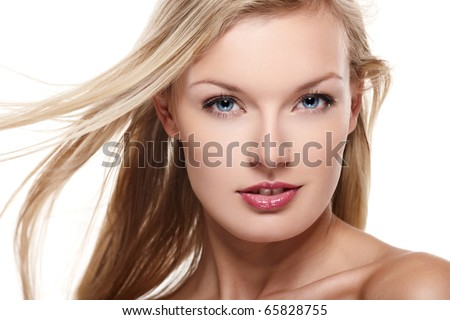 Portrait of beautiful female model on white background - stock photo