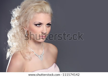 Portrait of beautiful female model  with blond hair style - stock photo