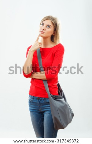 Portrait of  beautiful female student thinking.Student thinking - stock photo