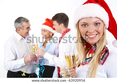 Portrait of beautiful female with champagne on background of her partners