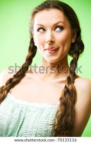 Portrait of beautiful funny girl lick of lips - stock photo
