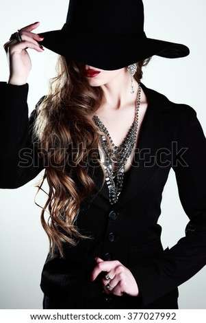 Portrait of beautiful girl in hat - stock photo