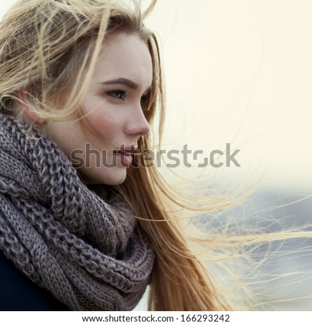 Portrait of beautiful girl in profile close-up in the wind