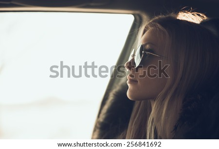 portrait of beautiful girl in sunglasses in the car - stock photo