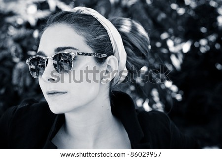 portrait of beautiful girl in the park - stock photo