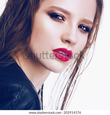 Portrait of beautiful girl in the studio with bright makeup and red lipstick, close up - stock photo
