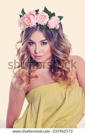 portrait of beautiful girl in wreath of flowers - stock photo