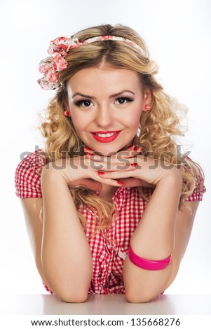 Portrait of beautiful girl model in pin-up