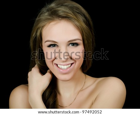 Portrait of beautiful girl on black background - stock photo