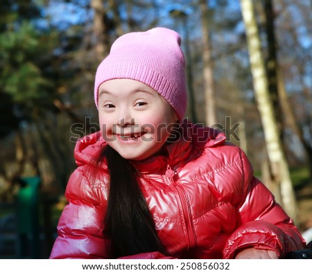 Portrait of beautiful girl on the playground - stock photo