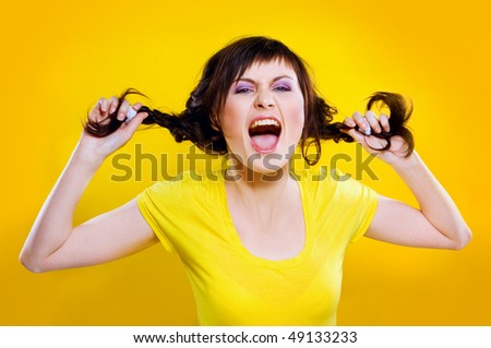 portrait of beautiful girl on yellow background - stock photo