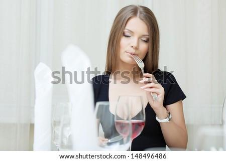 Portrait of beautiful girl posing in restaurant - stock photo