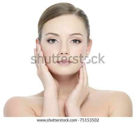 Portrait of beautiful girl stroking her pretty face with healthy skin - white background - stock photo