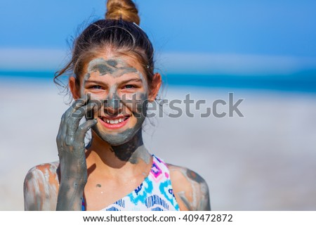 Portrait of beautiful girl taking Mud SPA At The Dead Sea, Israel. - stock photo
