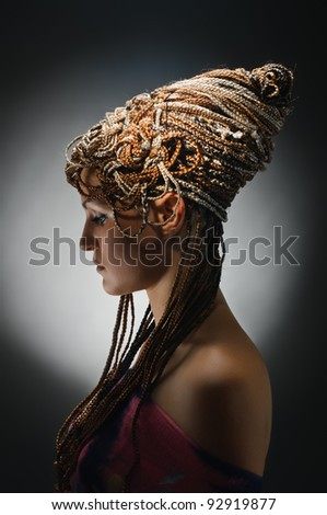 portrait of beautiful girl with african plaits on grey - stock photo