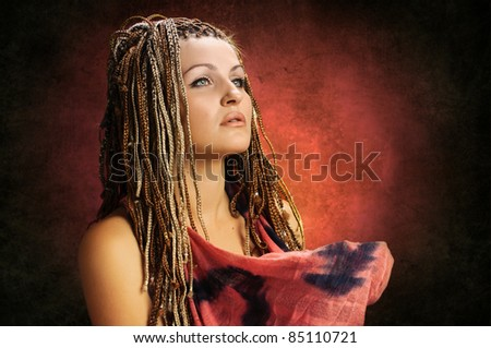 portrait of beautiful girl with african plaits on red gradient - stock photo