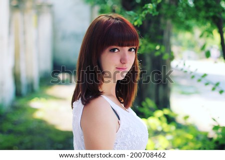 Portrait of beautiful girl with bangs. Soft sunny colors. Photo toned style instagram filters