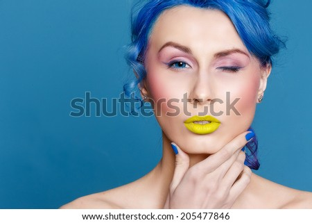 Portrait of beautiful girl with blue hair - stock photo