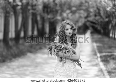 Portrait of beautiful girl with bouquet.