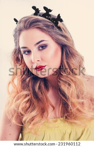 portrait of beautiful girl with butterflies on her head - stock photo