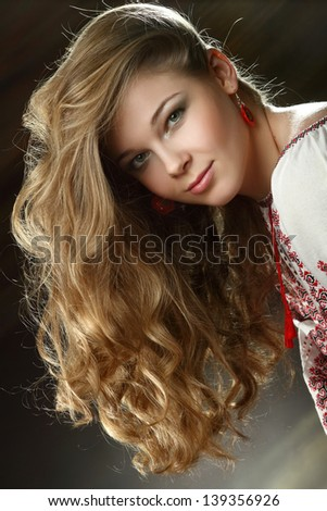 portrait of beautiful girl with curly blond hair - stock photo