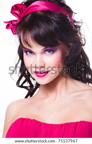 Portrait of beautiful girl with dark long curly hair and vibrant Make-up wearing pink satiny ribbon on white background - stock photo