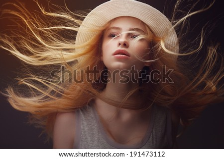 Portrait of beautiful girl with developing hair