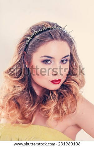portrait of beautiful girl with Eiffel tower on the head - stock photo