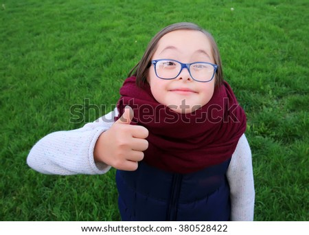 Portrait of beautiful girl with glasses in the park - stock photo