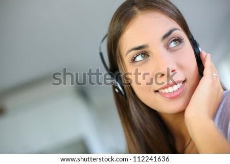 Portrait of beautiful girl with headphones on - stock photo