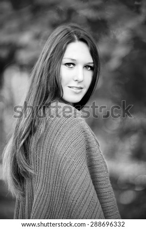 Portrait of beautiful girl with long hair walking in a park