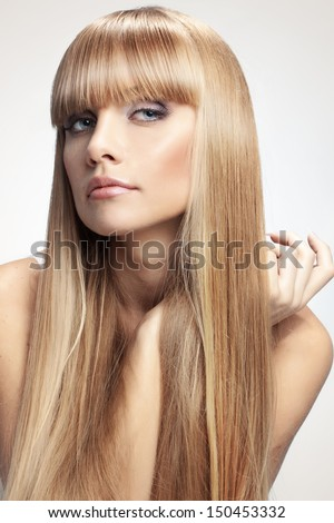 Portrait of beautiful girl with perfect long shiny blond hair studio shot - stock photo
