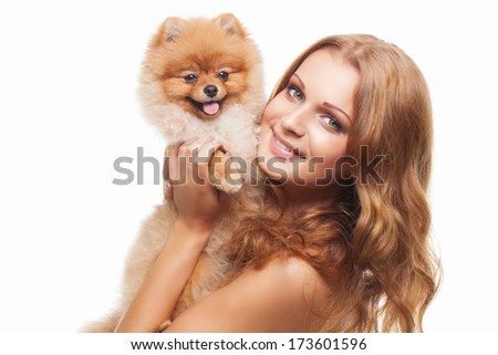 Portrait of beautiful girl with shpitz over white background