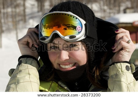 Portrait of beautiful girl with ski goggles on