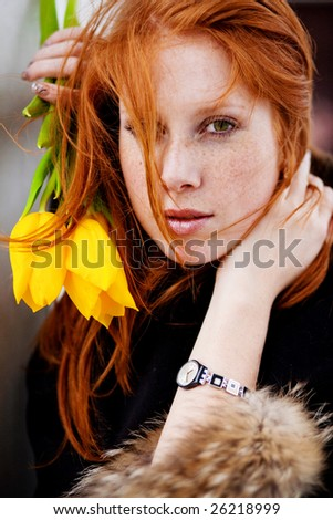 Portrait of beautiful girl with spring flowers