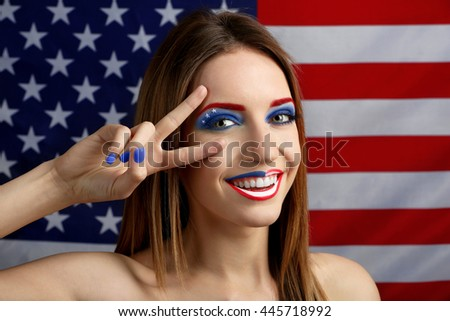 Portrait of beautiful girl with USA makeup