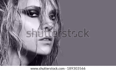 Portrait of beautiful girl with wet hair