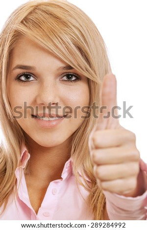 portrait of beautiful happy blonde girl showing thumb up - stock photo