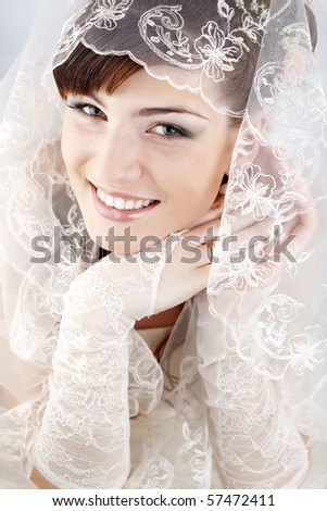 Portrait of beautiful happy bride close-up - stock photo