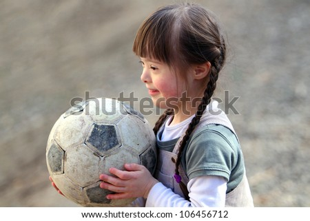 Portrait of beautiful happy girl with a soccer ball. - stock photo