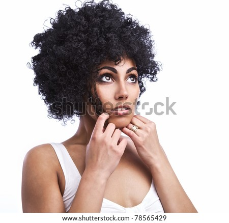 Portrait of Beautiful happy mulatto girl with smooth skin and dark curly hair, isolated.