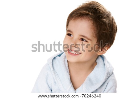 Portrait of beautiful happy smiling little boy in bathrobe on white background - stock photo