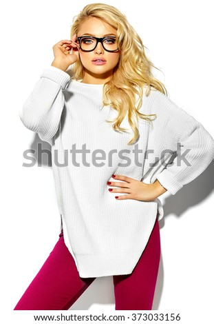 portrait of beautiful happy sweet cute sexy blonde woman girl in casual hipster warm white sweater clothes, in glasses - stock photo