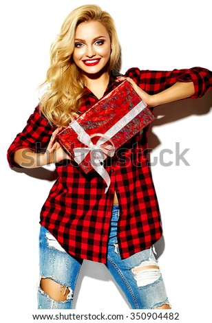 portrait of beautiful happy sweet smiling blonde woman girl holding in her hands Christmas gift box in casual red hipster winter checkered flannel shirt clothes and blue jeans - stock photo