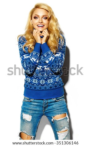 portrait of beautiful happy sweet smiling blonde woman girl in casual hipster warm winter clothes, in blue sweater  - stock photo