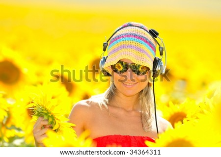 portrait of beautiful happy woman listening to music