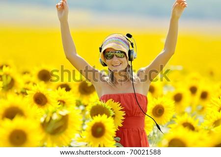 portrait of beautiful happy woman listening to music - stock photo